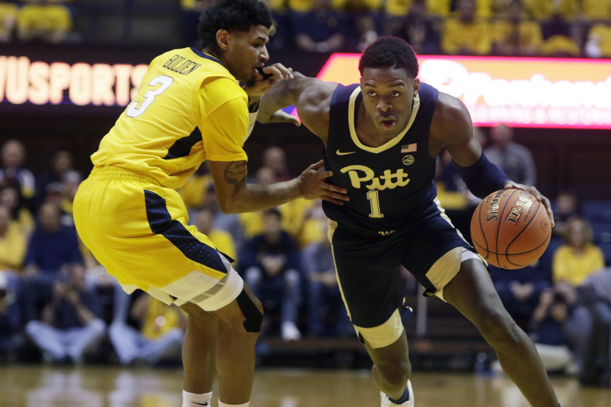 WVU Edges Pitt 69-59 in Backyard Brawl