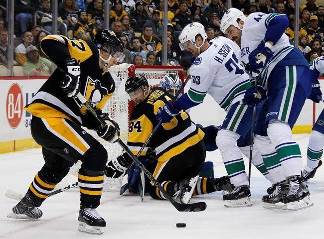 Ugly goals haunt Pens in 5-2 loss to Canucks