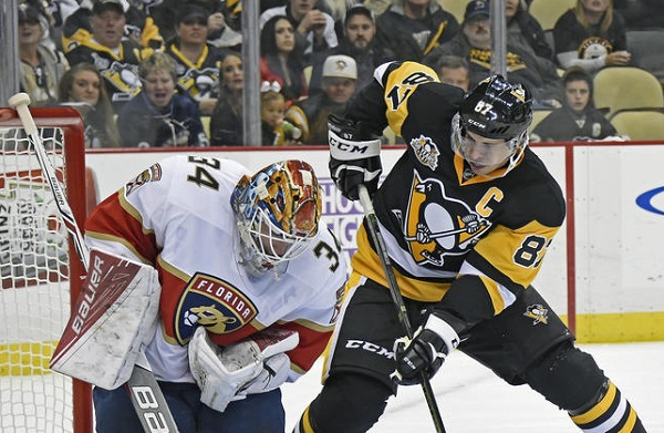 Crosby helps Penguins rally past Panthers in season debut